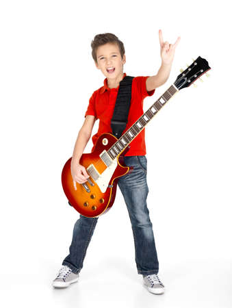 A young white boy sings and plays on the electric guitar with bright emotions, isolatade on white background photo