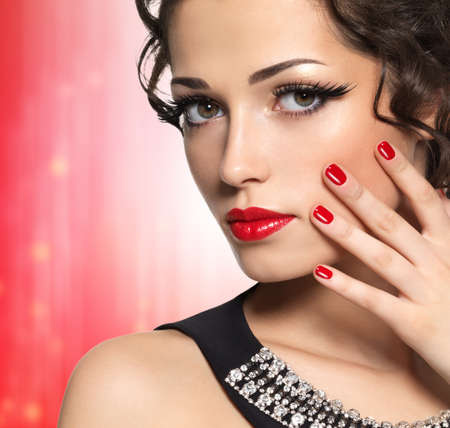 manicure woman: Beautiful  fashion model with red manicure and lips - isolated on white background Stock Photo