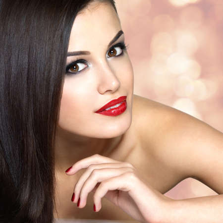 styled interior: Beautiful woman with long brown straight hairs. Blinking Background. Bokeh Stock Photo