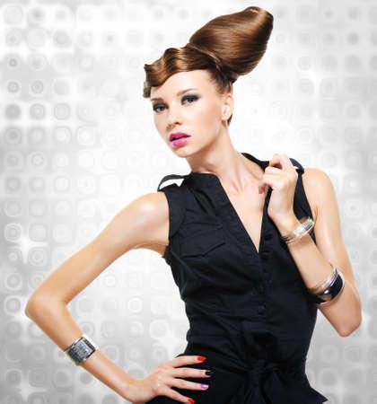 Beautiful woman dressed in black dress posing at studio Stock Photo - 17501655