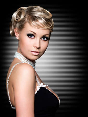 Blond woman with fashion beautiful hairstyle. Art background. photo