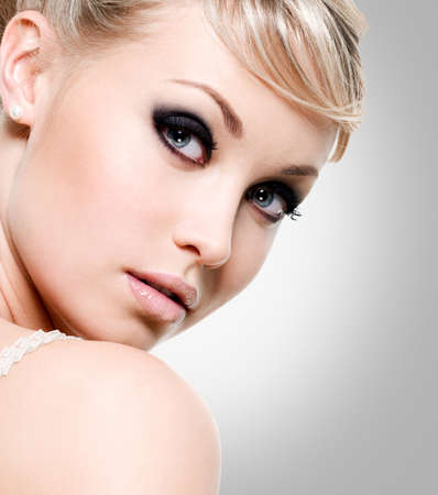 woman face close up: Beautiful  woman with style eye makeup. Close-up face of fashion model