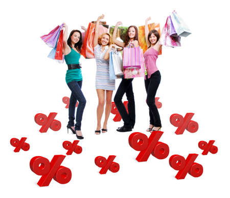 Group of happy women with shopping bags isolated on white. Girls standing on 3d text. photo