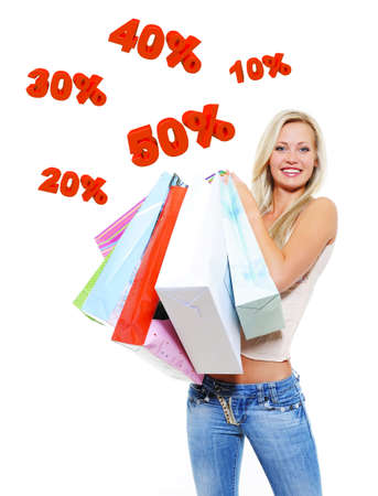 Happy woman with shopping bags isolated on white. Girl standing on 3d text. photo