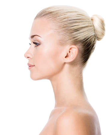 side pose: Profile portrait of  young blond woman - isolated