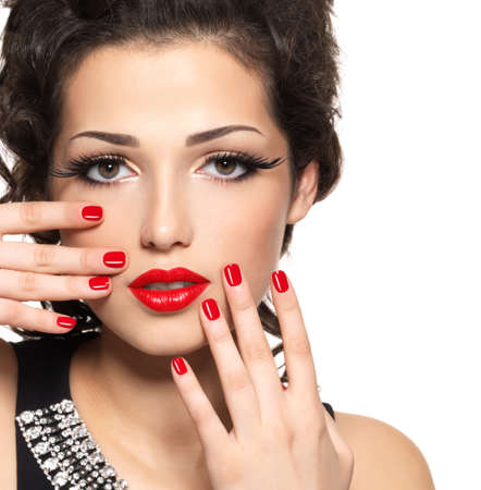 Beautiful  fashion model with red manicure and lips - isolated on white background photo