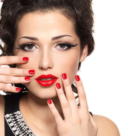 false eyelash: Beautiful  fashion model with red manicure and lips - isolated on white background Stock Photo