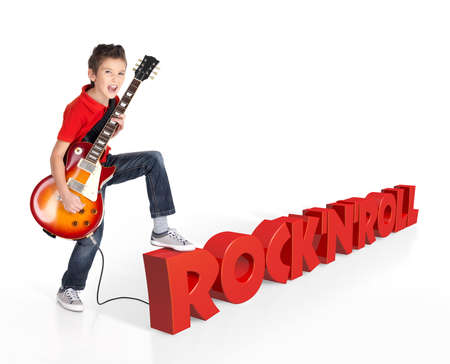 boy playing guitar: Boy plays  on electric guitar. The boy stands on the word of the rocknroll from the 3d text - isolated on white background  Stock Photo