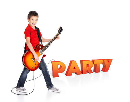 Boy plays  on electric guitar. The boy stands on the word of the party from the 3d text - isolated on white background photo