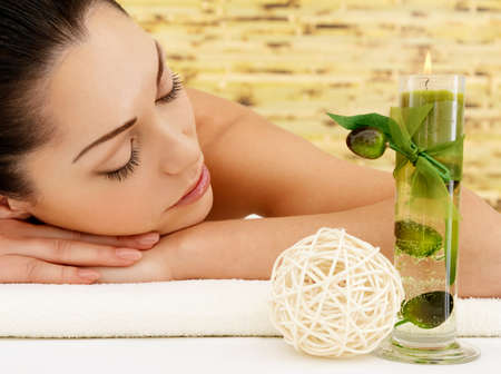 Relaxing white woman at beauty spa salon. Recreation therapy. Resting female with closed eyes Stock Photo - 17853354