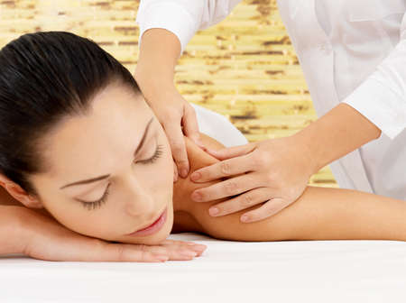 hands massage: Woman on spa massage of body in the beauty salon.  Stock Photo