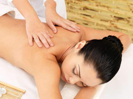 relax massage: Woman having massage of body in the spa salon. Beauty treatment concept.