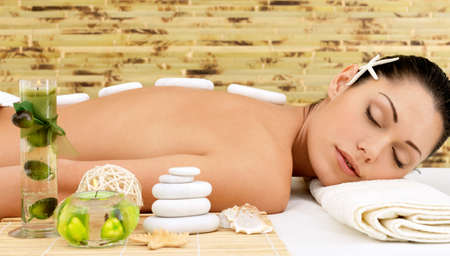 Stone massage for young woman at beauty spa salon. Recreation therapy. Stock Photo - 17853325