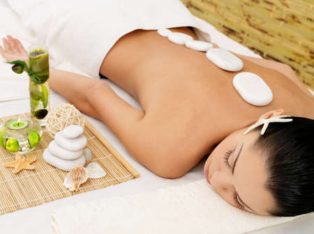 Stone massage for young woman at beauty spa salon. Recreation therapy.  Stock Photo - 17853337