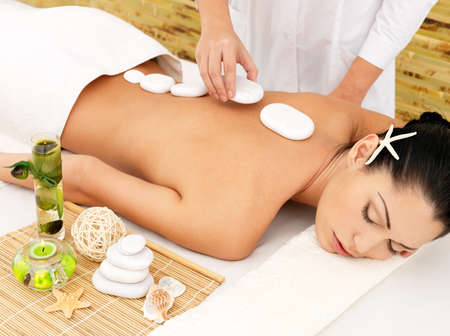 Woman having hot stone spa  massage of back in beauty salon Stock Photo - 17853377
