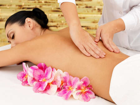 Woman on healthy massage of body in the spa salon. Beauty treatment concept. photo