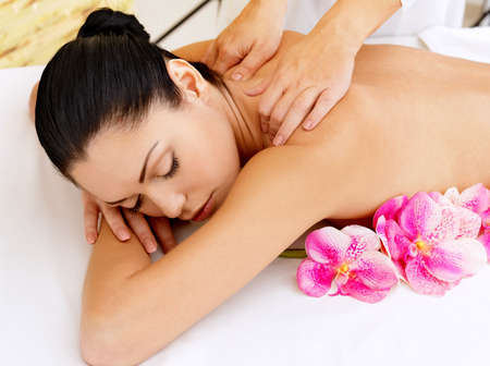 relax massage: Woman on healthy massage of body in the spa salon. Beauty treatment concept. Stock Photo