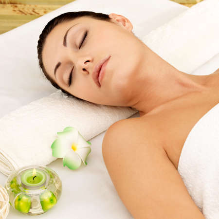 Relaxing white woman at beauty spa salon. Recreation therapy. Resting female with closed eyes Stock Photo - 17853302