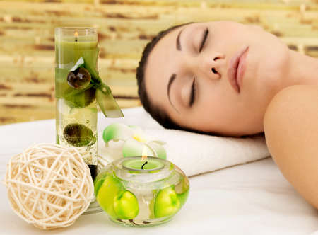Relaxing white woman at beauty spa salon. Recreation therapy. Resting female with closed eyes Stock Photo - 17853343