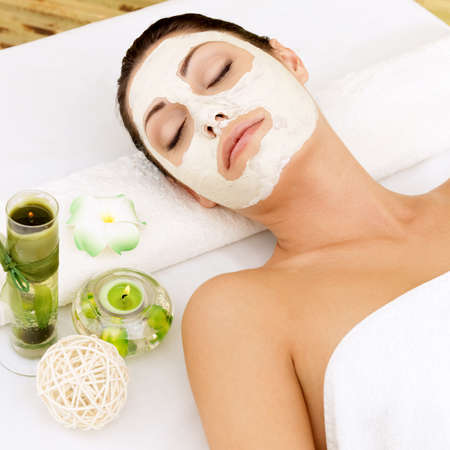 Relaxing woman at spa salon with cosmetic mask on face .   Stock Photo - 17853303