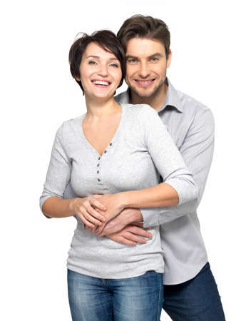 幸せなカップルの白い背景で隔離の肖像画。魅力的な男性と女性の遊び心のあるされています。