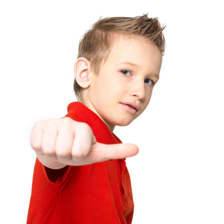 9 year old: Portrait of boy showing thumbs up sign isolated on white background