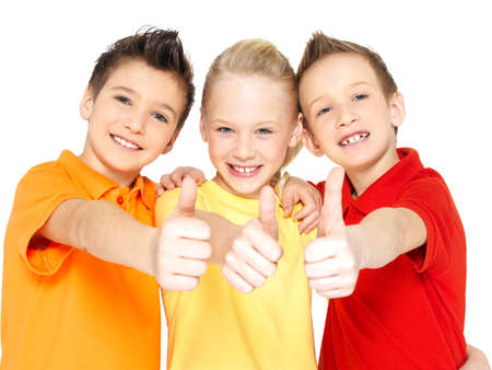 Portrait of the happy children with thumbs up gesture  isolated on white. Stock Photo