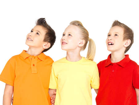 look: Portrait of the happy children looking up - isolated on white
