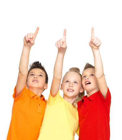 kid pointing: Portrait of the happy children point up by fingers on something away -  isolated on white