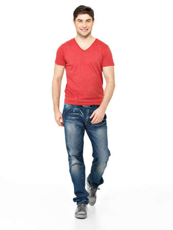 Full portrait of smiling  walking man in red t-shirt casuals  isolated on white background.   photo