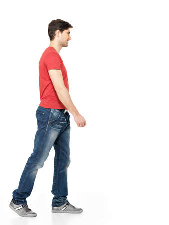man profile: Full portrait of smiling  walking man in red t-shirt casuals  isolated on white background.