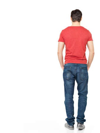 Full portrait of man standing back in casuals - isolated on white background  photo
