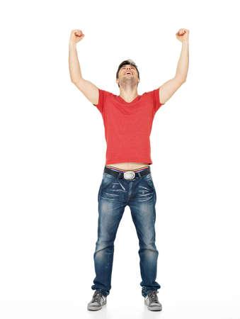 manos levantadas: Hombre joven feliz con en casuals con las manos levantadas hacia arriba aislados en fondo blanco.