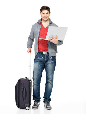 unblemished: Full portrait of young smiling happy man with suitcase and laptop- isolated on white  Stock Photo
