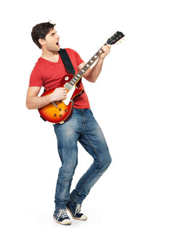 playing guitar: Young guitarist plays on the electric guitar with bright emotions, isolatade on white background