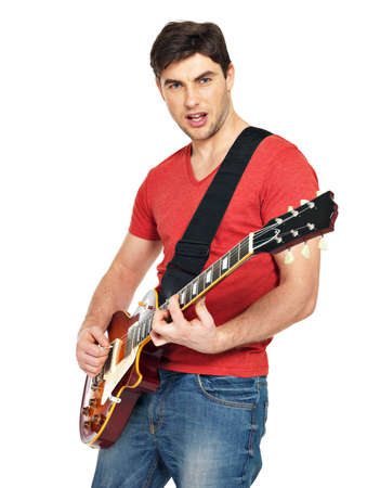 guitarist  man plays on the electric guitar with bright emotions, isolatade on white background photo