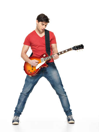 Guitarist  man plays on the electric guitar with bright emotions, isolatade on white background