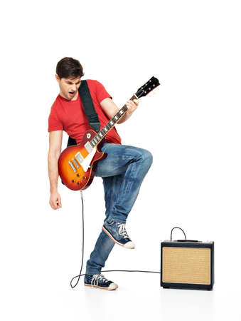 electric guitar: Guitarist  man plays on the electric guitar with bright emotions, isolatade on white background