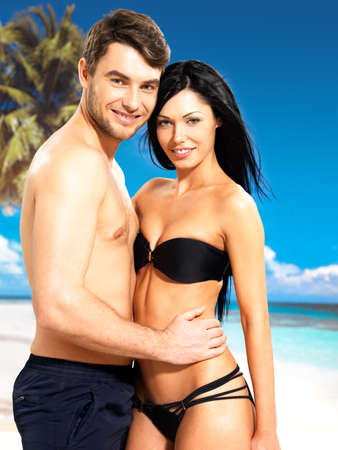 Portrait of  happy smiling beautiful couple in love  at tropical beach photo