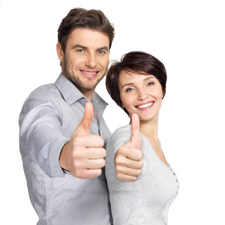 Portrait of happy couple with thumbs up sign isolated on white background Stock Photo