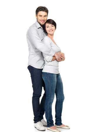 couples hug: Full portrait of happy couple isolated on white background. Attractive man and woman being playful.