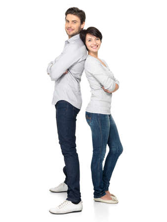 a young man: Full portrait of happy couple isolated on white background. Attractive man and woman being playful.