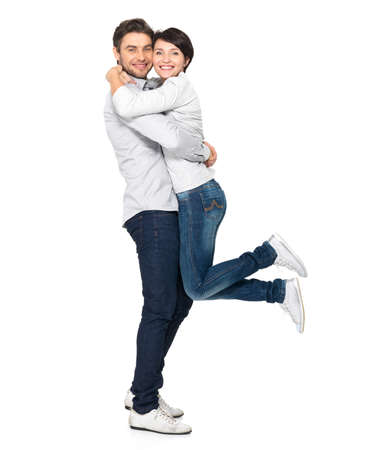 young man standing: Full portrait of happy couple isolated on white background. Attractive man and woman being playful.