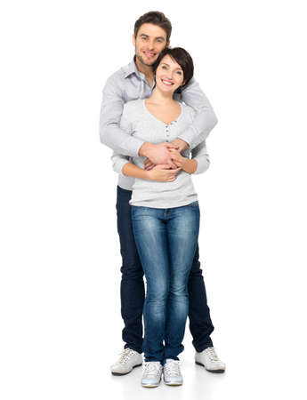 young couple smiling: Full portrait of happy couple isolated on white background. Attractive man and woman being playful.