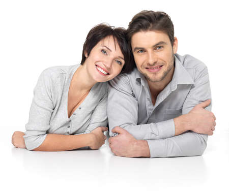 young couple smiling: Portrait of happy couple isolated on white background. Attractive man and woman being playful.