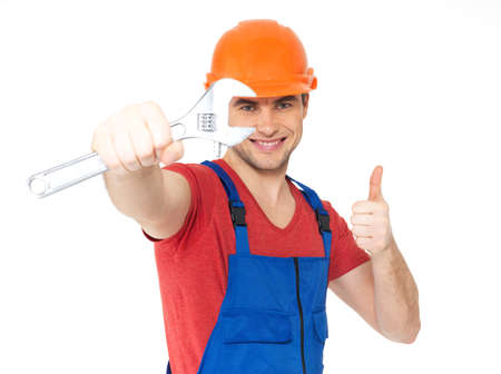 Portrait of happy worker with spanner showing thumbs up sign isolated on  white background photo
