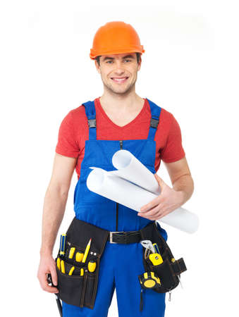 Portrait of smiling handyman with tools and paper  isolated on  white background photo