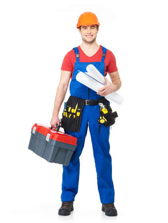 Portrait of smiling handyman with tools and paper  isolated on  white background Stock Photo - 18629023