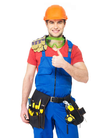 Portrait of happy handyman with tools showing thumbs up sign isolated on  white background photo