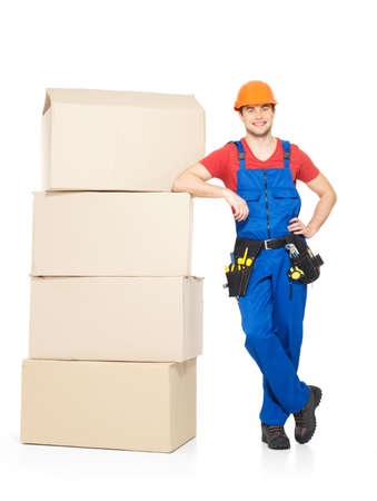 Portrait of  young delivery worker man with paper boxes isolated on white background photo